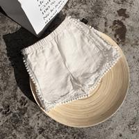 กางเกงขาสั้นผ้านิ่ม-แต่งพู่กลมสุดเก๋-สีขาวครีม