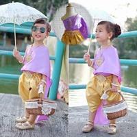 ชุดไทยเด็ก-โจงกระเบนดิ้นทอง_-สไบสีม่วง