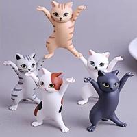 ตุ๊กตาแมวเต้นรำวางปากกา-เครื่องประดับ-หูฟังAirpod(แพค5ตัว)